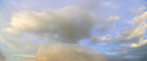 Clouds in the sky at golden hour photo