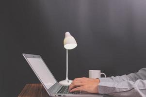 Professional working on laptop mock-up photo