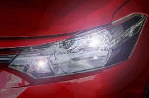 Headlight on a red car