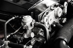 Greyscale photo of car engine