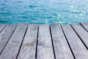 Wood tabletop for display with blue water for background