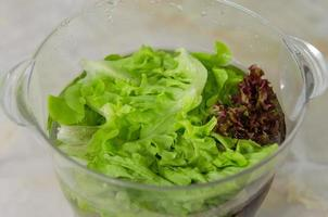 Washing lettuce in a glass bowl