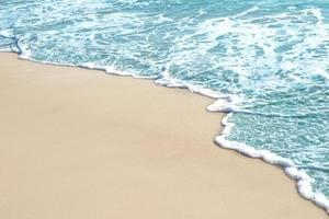 Blue sea on sandy beach