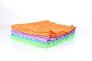 Colorful cleaning microfiber cloths on a white background