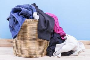 Clothes in wooden basket on floor