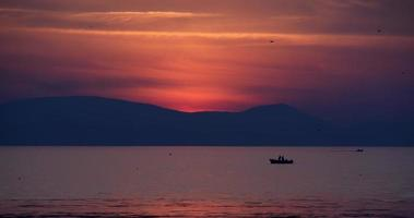 Fishermen On The Sea During Sunset