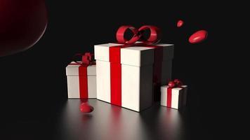 Caja de regalo y corazón rojo cayendo sobre fondo negro