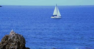 Sailing Yacht Moving in The Endless Horizon