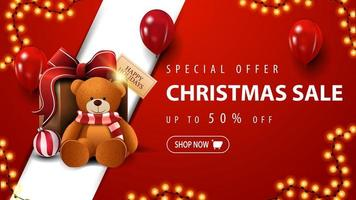 Special offer, Christmas sale, up to 50 off, red discount banner with garland, red balloons and present with Teddy bear vector