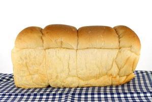 Bread loaf on blue cloth photo
