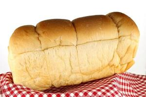 Bread loaf on red cloth photo
