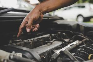 Man checking a car engine