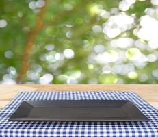 Black plate on cloth outside photo
