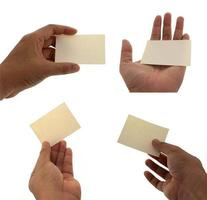 Hands holding sticky note