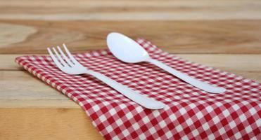Fork and spoon on red cloth photo