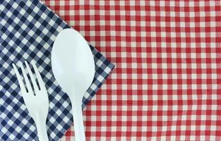 Fork and spoon on cloth photo