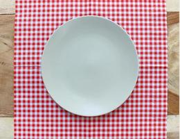 Top view of plate on cloth photo