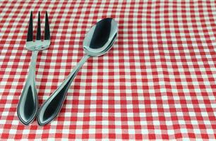 Silverware on red cloth photo