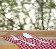 Fork and spoon on cloth outside photo