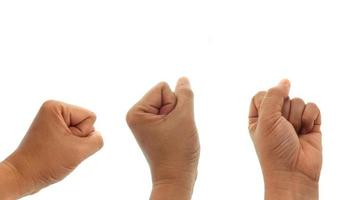 Three fists on a white background