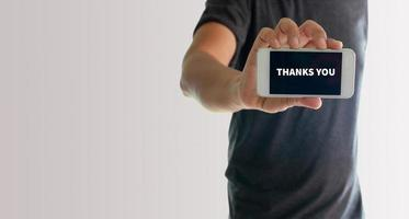 Man showing phone with thank you on screen