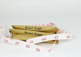 Sugar packets and measuring tape