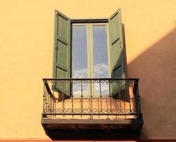 Green shutters on window photo
