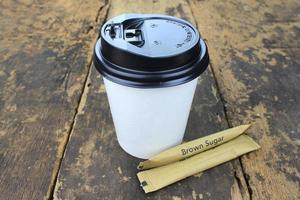 Coffee cup and sugar packets