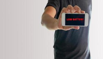 Man showing phone with low battery on screen photo