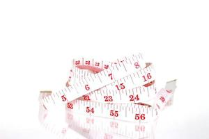 White and red measuring tape photo
