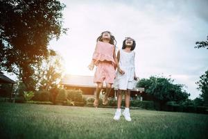 Two little girls having fun playing in the park