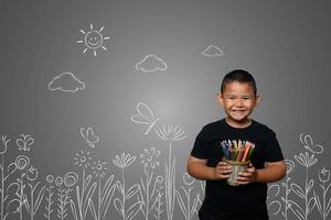 A boy with pencils drawing a dream background photo