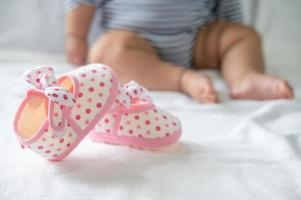 Newborn shoes on a white mattress