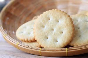 Crackers in wooden basket photo