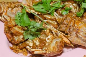 Seafood with cilantro garnish