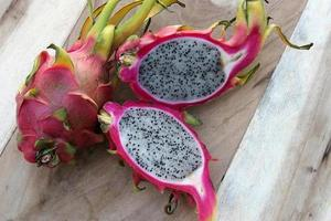 Dragon fruit on wooden table photo