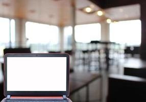 Blank laptop screen in restaurant photo