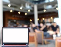 Laptop mock-up at cafe photo