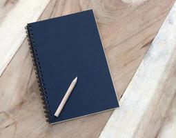 Black notebook and pencil