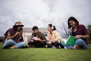 Group of students sitting at a park after class