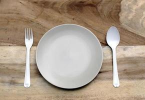 Gray plate and silverware photo