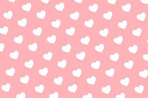 Pattern of white hearts on pink background for Valentine's day greeting card