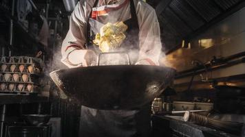 Chef cooking on wok