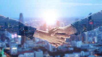 Double exposure business handshake photo