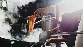 Chef cooking noodles