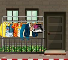 Many clothes hanging on a clothes rack in front of the house scene vector