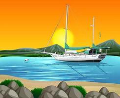 playa al atardecer escena con barco en el mar vector