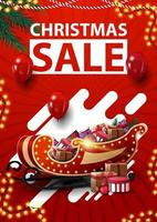 Christmas sale, red vertical discount banner with garlands, red balloons, abstract shapes and Santa Sleigh with presents vector