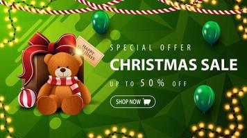 Special offer, Christmas sale, up to 50 off, beautiful green discount banner with polygonal texture, garlands, green balloons and present with Teddy bear vector