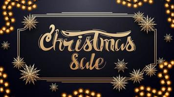 Christmas sale, dark blue discount banner with garland, gold vintage frame and paper gold snowflakes vector